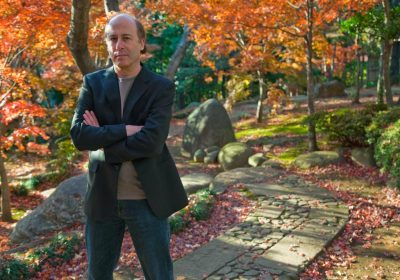 Tokyo author, Barry Lancet, is a thriller writer seen here in a Japanese garden, located in the Daikanyama district of Tokyo, Japan.